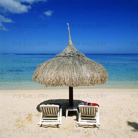 Solstolar på strand, Mauritius