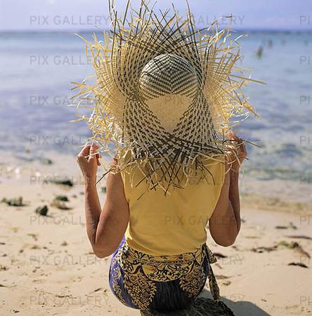 Kvinna på strand