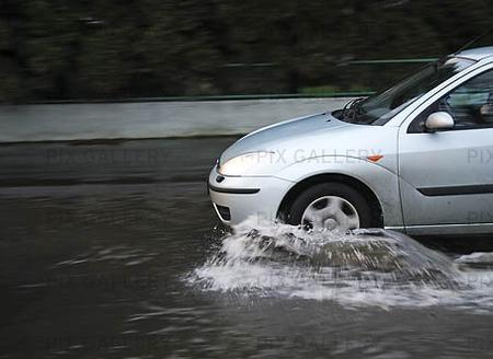 Car on flooded street