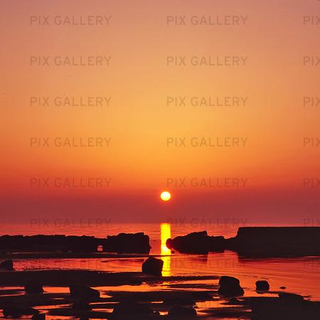Solnedgång, västkusten
