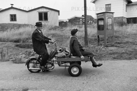 Mature couple on cargo moped