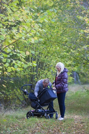 Familj med barnvagn