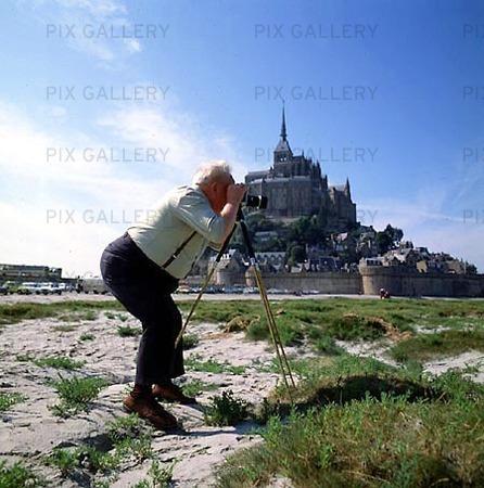Fotograf vid Mont S. Michel, Frankrike
