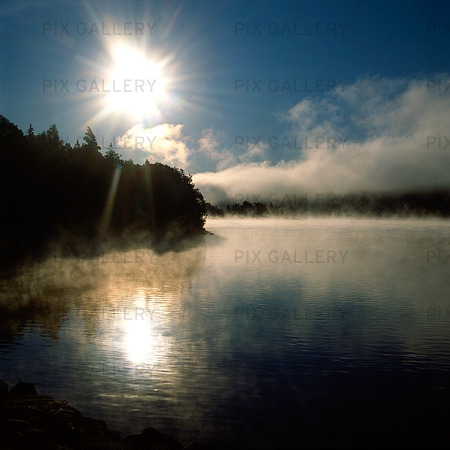 Lake with morning mist