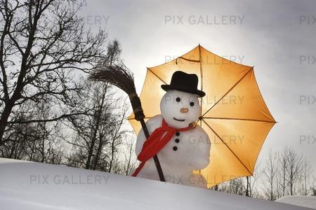 Snögubbe med paraply