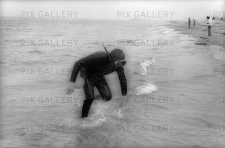 Dykare på strand