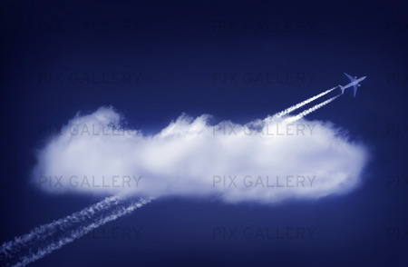Aircraft flying through a white cloud