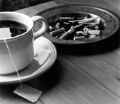 Teacup in ashtray