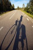 Skugga av cyklist