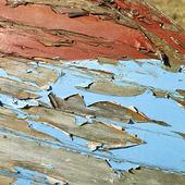 Avflagad färg på träbåt