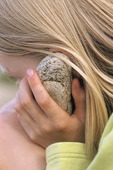 Girl with stone