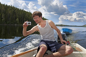 Semesterfotograf i fritidsbåt