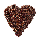 Heart symbol made of coffee grains