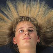 Kvinna med utbrett hår