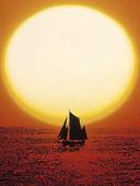 Segelskuta i solnedgång
