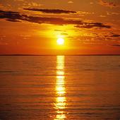 Solnedgång vid hav