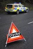 Varningstriangel och polisbil