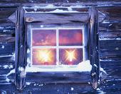 Stearinljus i fönster