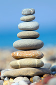 Pile of pebble Stones over blue sky and sea