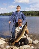 Fritidsfiskare med gädda