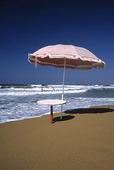Parasoll på strand