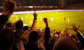 Fans upphetsad på en fotbollsmatch
