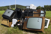 Scrapped TVs along a road on the High Coast