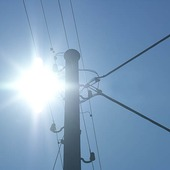 The sun at the power poles