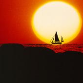 Segelbåt i solnedgång (montage)
