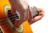 Spela gitarr
