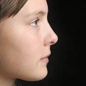 Profil av flickansikte