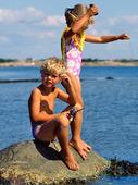 Barn fiskande krabbor