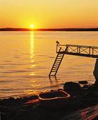 Solnedgång vid brygga