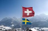 Schweizisk och svensk flagga
