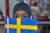 Invandrare med Svenska flaggan