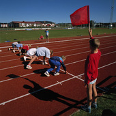 Barn på löparbana