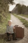 Pojke med resväska