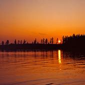 Solnedgång i sjö