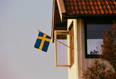 Svensk flagga på hus
