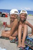 Flickor på strand