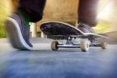 Boy on a used skateboard