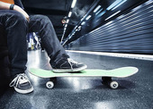 Boy with skateboard at Subway