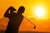 Silhouette av en golfare