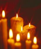 Brinnande stearinljus
