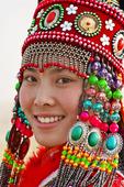Flicka i traditionella kläder från Mongoliet, Kina