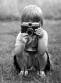Flicka med kamera