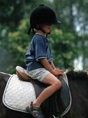 Pojke på häst